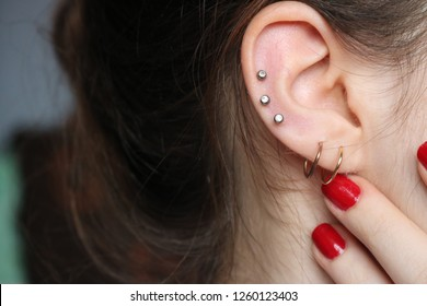 ear piercings photos.Helix piercing.Ear rings