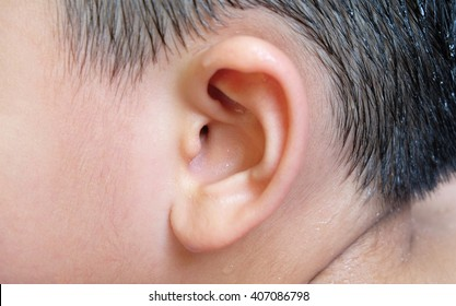 ear wall at entrance to inner ear with water drops of a asian boy with black hair