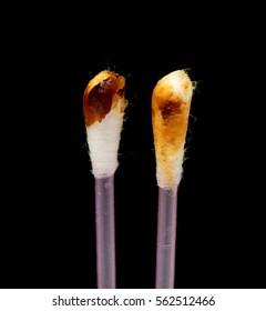 Ear wax on a cotton swab, cerumen