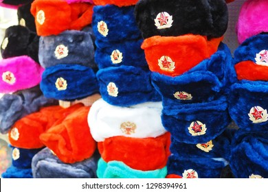 d1690e1cd6a Earflaps fur caps with red stars in a souvenir shop in Moscow. Winter hats