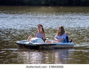 EARLSWOOD, SURREY/UK - JULY 31 : Enjoying a pedallo on Earlswood Lake Surrey on July 31, 2020. Three unidentified people