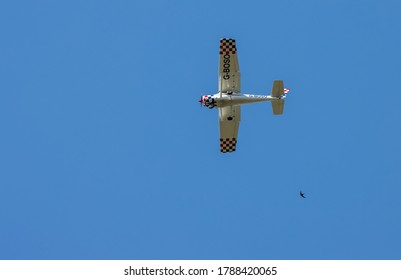 EARLSWOOD, SURREY/UK - JULY 31 : Light plane G-BOSO - Cessna A152 Aerobat flying over Earlswood Surrey on July 31, 2020