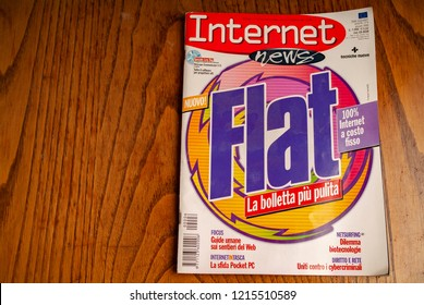 Early 2000s Internet italian magazine speaking about flat connection.kitchen wood table inside a private apartment. Italy Europe