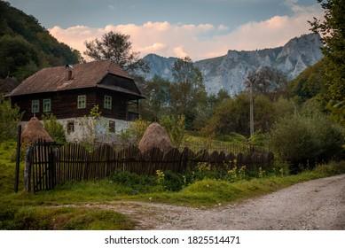 Early autumn landscape with a Romanian traditional house in Sacrita Belioara Natural Park. Located in Apuseni Mountains, Transylvania, Romania