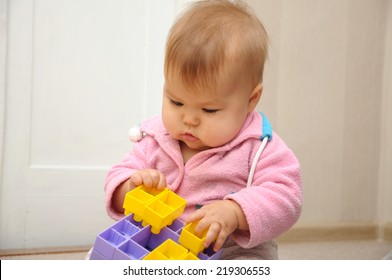 early brain development toys for kids - baby sitting quite and playing with colored constructor, child thinking, children education, human evolution