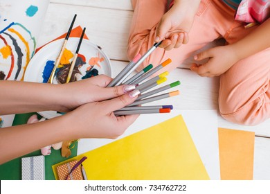 Early childhood education. Work tith mom together. Artistic child, unrecognizable art family top view, colorful drawing, creativity concept