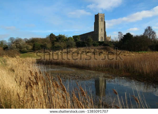 Early Christian Holy Trinity Church, Blythburgh Suffolk England UK known as cathedral of the marshes with reflection in water