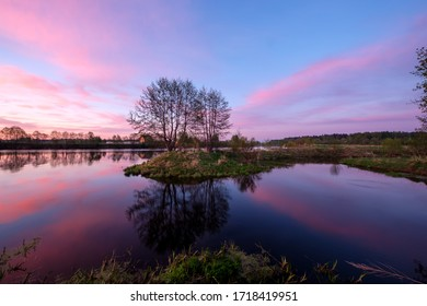 Early colorful sunrise by the river