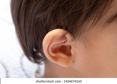 Early diagnosis of hearing problems in children. Close-up of an