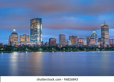 Early Evening View of the Boston Skyline with brightly illuminated buildings