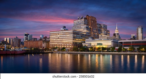 Early evening view and city lights of West Chelsea and Midtown Manhattan skyline from Hudson River. New York City