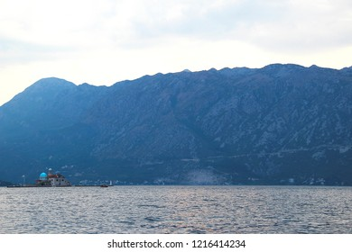 Early evening view of Gospa od Skrpjela island church in Kotor bay, Montenegro.