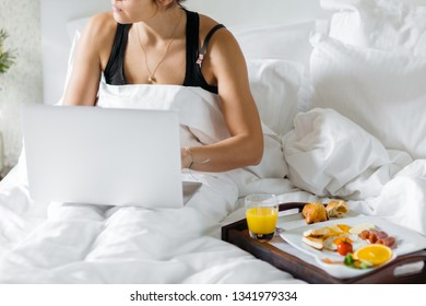 Early job on laptop with breakfast