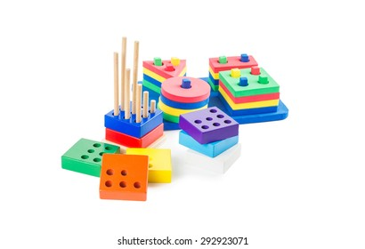 Early learning Montessori toys:  multicolored logical and geometric pyramids for geeks isolated on white background