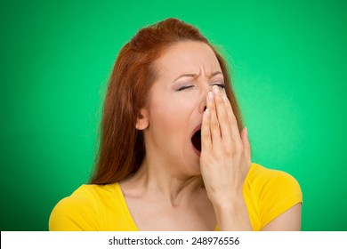 It is too early for meeting. Closeup portrait headshot sleepy young woman with wide open mouth yawning eyes closed looking bored isolated green background. Face expression emotion body language