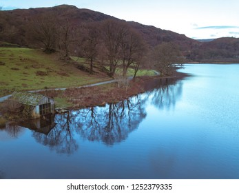 Early morning aerial view of Grasmere shore line walking path in the Lake District, UK.