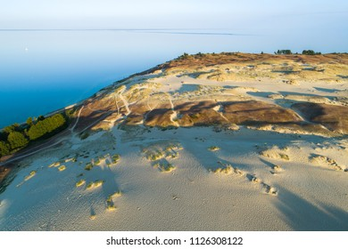 Early morning aerial view of Parnidzio dune meeting sea in Curonian spit near Nida, Lithuania