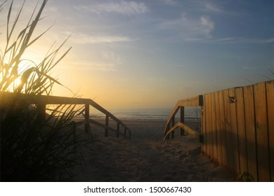 Early morning at the Atlantic beach. Scenic marine landscape with way to the beach through sand dunes and calm ocean in soft sun light during sunrise at Pawleys Island, South Carolina, USA.
