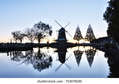 Early morning in the autumn, The beautiful reflection of windmill, Kashiwa City, Chiba Prefecture, Japan.