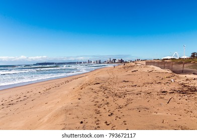 Early morning beach and sea against blue sky and city skyline in Durban, South Africa