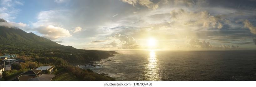 Early morning, beautiful golden sea sunrise at Yakushima island rocky coast colorful panorama, sun reflecting in the sea