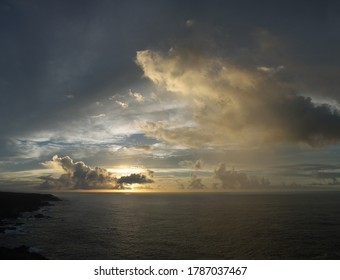 Early morning, beautiful golden sea sunrise at Yakushima island, rocky coast in haze