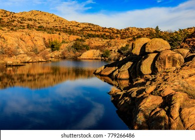 Early morning breeze distorts rocky reflection in water at Wichita Mountains National Wildlife Refuge, November 2017