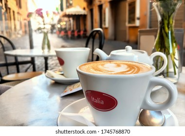 Early Morning Cappuccino at Sunrise along Traditional Italian Street in Rome, Italy