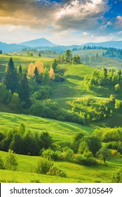 Early morning in a Carpathian mountain valley with beautiful light of sunrise. Ukraine, Europe.
