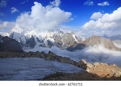 Early morning in caucasus mountains. On a background north face of mount Dykh-tau. It is second highest mountain in Europe. Its height 5206 meters