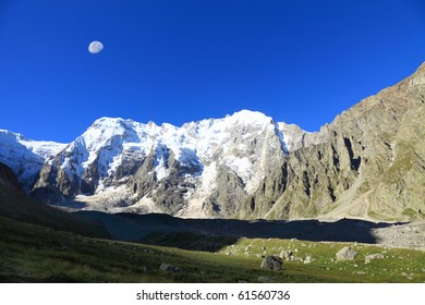 Early morning at the caucasus. On a background north face of mount Dykh-tau. It is second highest mountain in Europe. Its height 5206 meters