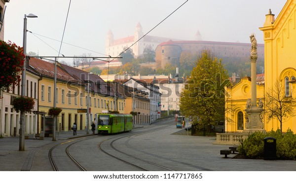 Early morning in center of Bratislava with tramline and historic architecture