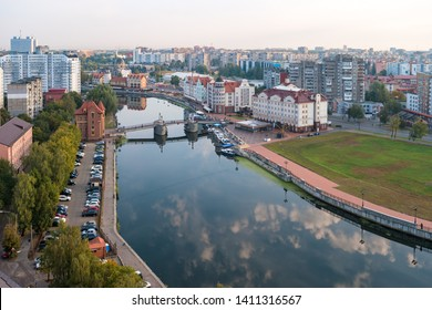 Early morning in the city of Kaliningrad. Calm river Pregolya with a reflecting sky. Panoramic view of the Jubilee Bridge and the Fishing Village.