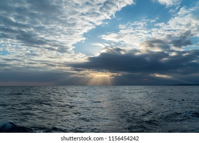 in early morning, cloudly weather, light rays appear between clouds