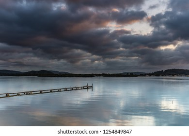 Early Morning Clouds and Reflections on the Bay - Woy Woy Waterfront on the Central Coast, NSW, Australia.
