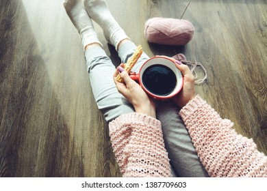 Early morning with coffee and crafts, knitting baby socks