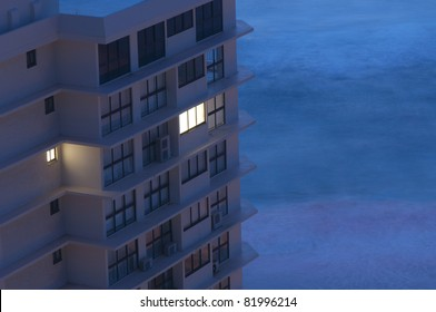 Early Morning Concept - A Building with Light in only One Window