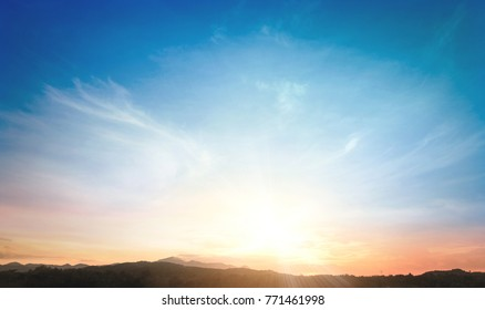 Early morning concept: Sun light and mountain sky of heaven autumn sunset background