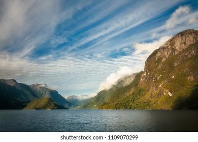 Early Morning Cruise across Lake Manapouri on a adventure ride to the remote Doubtful Sound in Fiordland National Park, New Zealand, South Island.