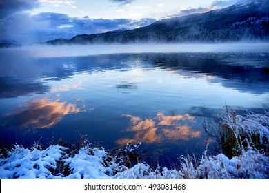 Early morning and first autumn snow on Yazevoe lake in Altai mountains, Kazakhstan, Central Asia