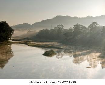 Early morning fog on river at kaziranga, Assam, India