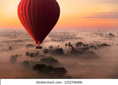 early morning hot air balloon flight over the temples of Bagan.