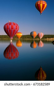 Early morning hot air balloon launch over water in Northwest New Mexico.