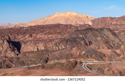 early morning at the israel egypt border in the eilat mountains showing an access road that ends at the sinai barrier fence