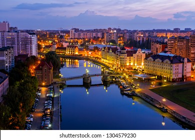 Early morning in Kaliningrad. River Pregolya, Embankment of the Fish Village and the Jubilee Bridge. Russia, Kaliningrad