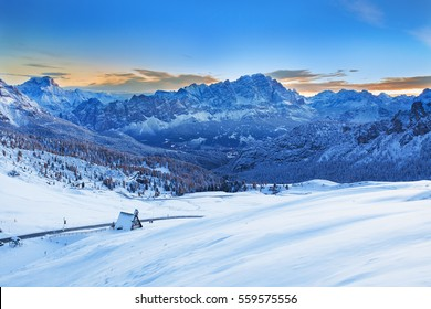 Early morning landscape of Marmolada summit with first rays in Dolomites in winter from Passo Giau, Dolomites, Italy