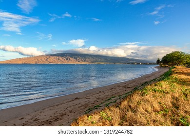 Early morning light on the beach at Kihei with the West Maui Mountains in the distance