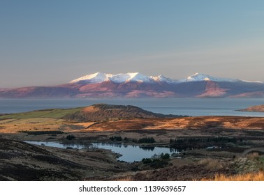 Early in the morning the light rises causing magical light and shadows accross Dalry Moor and onto Arran accross the Clyde estury.