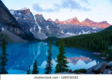 Early Morning Light Shines on the Mountains of the Canadian Rockies Overlooking a Serene Turquoise Lake, Alberta, CA