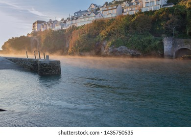 Early morning mist at Looe Harbour Cornwall